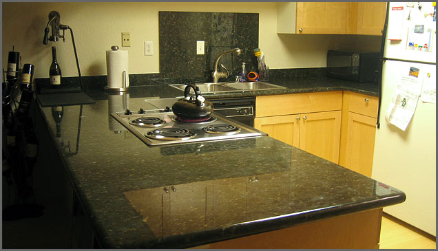 verde countertop with cabinets
